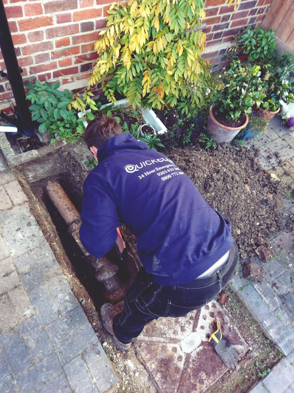 Quick Clear Drainage expert repairing a drain in London